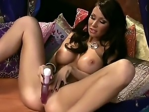 The amazing brunette pornstar Sandee Westgate with a big boobs masturbates...