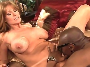 MIlf gets her pussy licked by a horny black guy with flirty long tongue