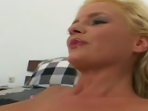 Sexy blonde babe enjoys as she is fingered and moans as her gaping cunt is...