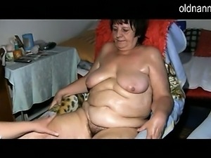 Granny with hairy pussy bathing herself to prepare