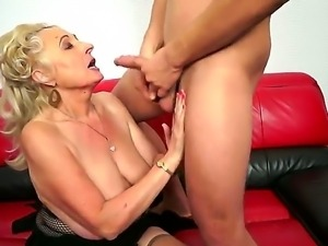 Horny blonde granny Sila enjoys young cock drilling her and filling her with...