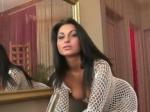 Incredibly sexy black haired babe Lioness strips demonstrating her beautiful...