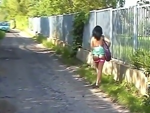 Kinky brunette chick Krystinka feels horny while walking in the park and...
