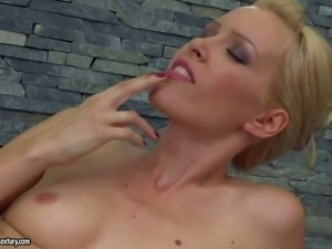 Attractive slender blonde babe with natural boobs and heavy make