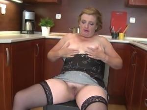 old blonde masturbates in the kitchen