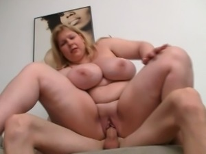 Busty mature enjoying young stud