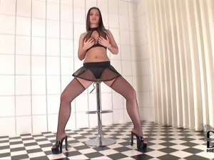 Eve Angel is a sexy dressed dark haired babe with