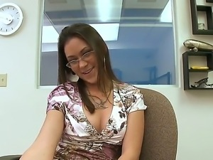 The attractive Kandi Milan was bored at the work and she masturbates her...