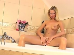 Horny blonde Martini loves to pleasure her twat with hard dildo and fingering...
