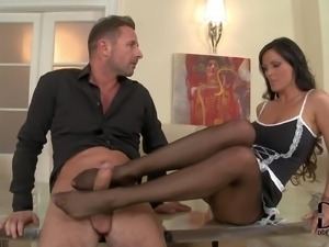 Sheila Grant is a charming long legged brunette in sexy