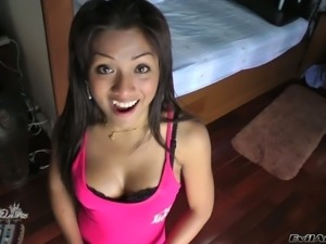 Black haired oriental shemale Nong with alluring smile is a