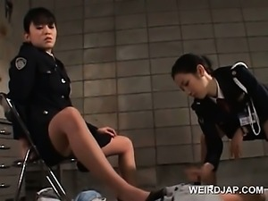 Dirty asian police women rubbing a convicts horny dick