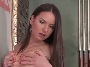 Busty russian brunette Nataly Gold fingers her beautiful muff as she moans...