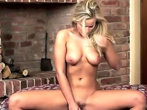 Aroused golden haired hottie Miela enjoys in playing with her shaved taco on...