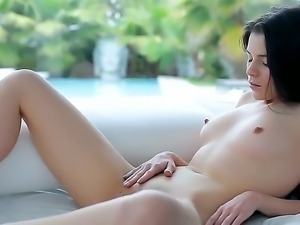 Stunning black haired beauty Valeria A is playing with her lusty shaved pussy