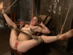 tied up whore gets a vibrator on her cunt