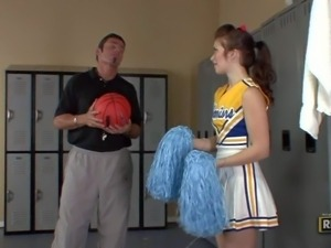 Ashlyn Rae is a cheerleader in uniform but with no