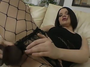 Brunette bitch stuffs butthole by huge black dildo and gives deep throat...