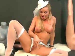 Precious blonde Silvia Saint in sexy white lingerie is standing on her knees...