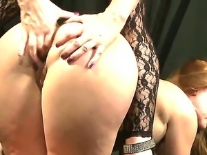 Redhead girls Alice King and Katy Parker are having lesbian bondage fun...