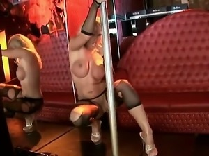 Arousing smoking hot blonde stripper Harmony Flame with big fake hooters and...