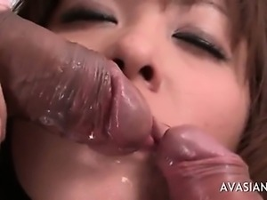 Asian slut gets her mouth double fucked