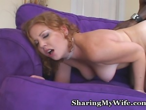 Redheaded babe takes thick black cock in homemade video for all to see!
