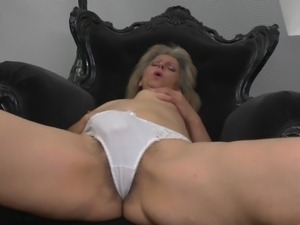mature blonde fingering her hairy pussy