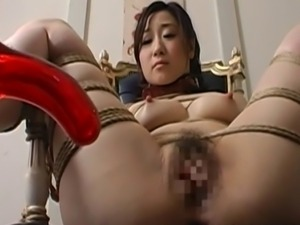 This Asian babe looks worried as she has been expertly tied to a chair with...