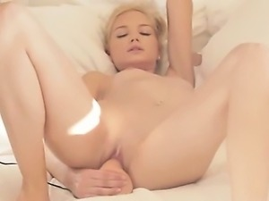 blond beauty riding her pussy with toy