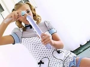 Blonde coed deep toying her anus