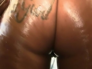Thick black slut Jazzy Lixxx drizzles oil all over her juicy ghetto booty