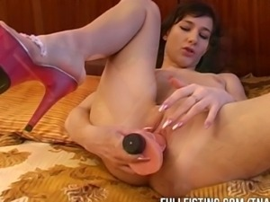 Watch this little horny fisting slut get her tight little pussy fisted to the...