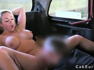 Huge tits blonde fucks on bonnet of fake taxi in public garage
