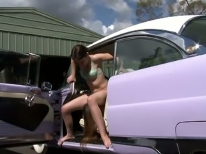 Teens licking in a retro car
