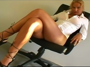 Hot blonde nurse fucks herself with dildo.