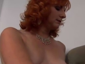 Sexy mature ginger babe frigs her pussy until she squirts