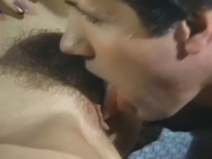 Nina Hartley and Tracey Adams share Eric Edwards' cock in the 1990 adult...