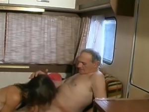 Mature couple fucks in the trailer.