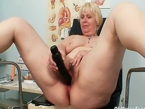 This chubby blond milf just turned fifty. This woman doctor enjoys inserting...