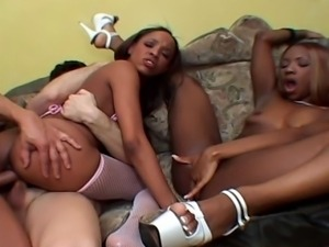 Two gorgeous black girls in hot interracial action
