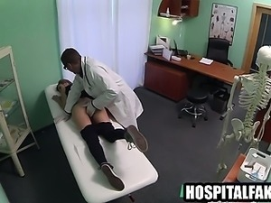 Brunette gets fingered while sucking her doctors cock