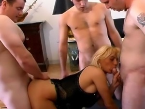 Blonde MILF whore gang banged by four guys.
