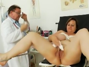 Olena with huge jugs is examined by perverted doc.