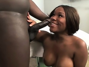 Busty black beauty on knees sucking cock