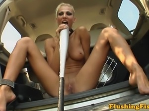 Solo lesbian slides onto a baseball bat with her gaping hole
