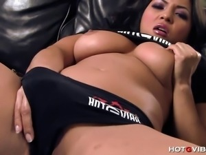 The naturally busty Asian penthouse pet, Adrianna Luna, tickles her clit with...