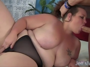 Sexy fat girl measures a cock to make sure it is big enough to fill her plump...