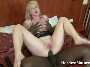 Blonde milf getting her ass fucked by a big black dong in this scene