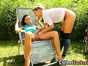 Clothed lesbians licking